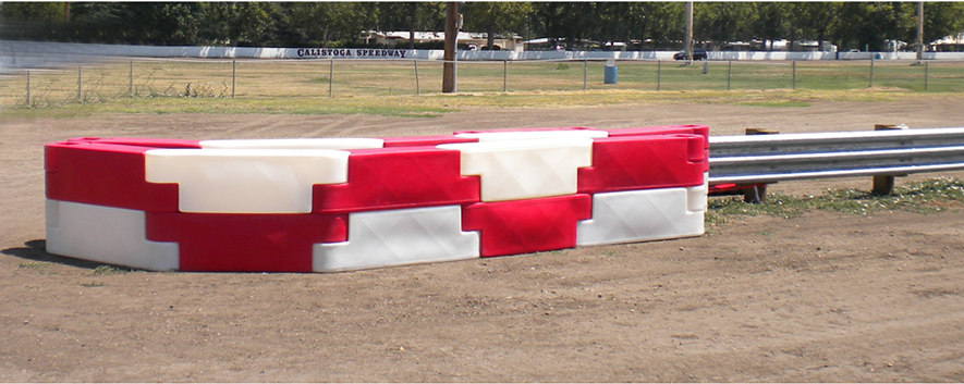 Double high barriers protecting the pit entrance at Calistoga Speedway in the Napa valley, Northern California.