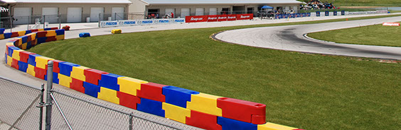 Barriers placed at the end of a straightway seperating the track from spectator viewing area at New Castle Raceway Park in New Castle, Indinia