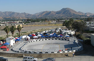 A view of the quarter midget track located at Orange Show Fairgrounds in Southern California.  Barriers are black and white.